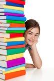 Estudiante y pila de libros Foto de archivo