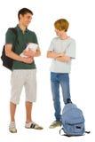 Estudiantes adolescentes con la mochila y los libros Imagen de archivo libre de regalías