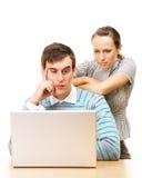 Estudiantes cansados con la computadora portátil Imágenes de archivo libres de regalías