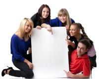 Estudiantes con la muestra en blanco Foto de archivo