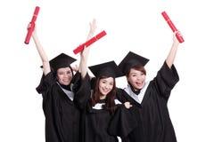 Estudiantes de graduados felices Imágenes de archivo libres de regalías