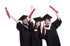 Estudiantes de graduados felices Foto de archivo libre de regalías