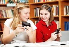 Estudiantes distraídos Foto de archivo libre de regalías