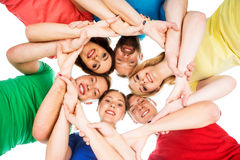 Estudiantes en ropa colorida que se ligan Fotografía de archivo libre de regalías