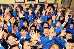 Estudiantes felices en la sala de clase Imagen de archivo
