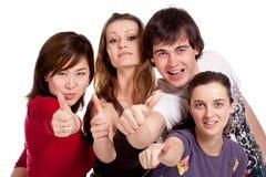 Estudiantes felices que muestran OK Imagen de archivo