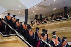 Estudiantes graduados de graduación Imágenes de archivo libres de regalías