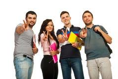 Estudiantes que muestran las manos de la victoria Foto de archivo libre de regalías