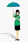 Estudiantes que sostienen un paraguas Imágenes de archivo libres de regalías