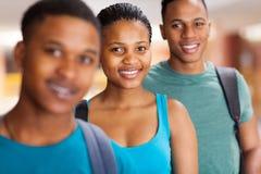 Estudiantes universitarios del Afro Imagen de archivo libre de regalías