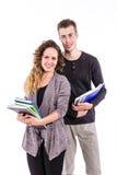 Estudiantes universitarios jovenes con los libros Fotografía de archivo