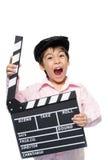Estudio de la pizarra de la toma del niño pequeño Foto de archivo libre de regalías