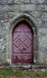 Estudio de una entrada roja de la iglesia Fotos de archivo libres de regalías
