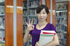 Estudio en una biblioteca Imagen de archivo