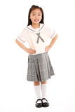 Estudio tirado de muchacha china en uniforme escolar Imagenes de archivo