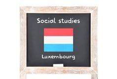 Estudios sociales con la bandera a bordo Fotos de archivo