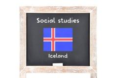 Estudios sociales con la bandera a bordo Fotografía de archivo libre de regalías