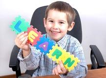 Estudo do menino a letra Fotografia de Stock