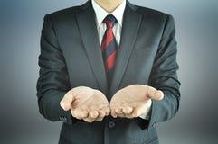 Esvazie as mãos abertas do homem de negócios Imagem de Stock Royalty Free