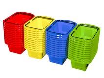Esvazie cestos de compras coloridos Imagens de Stock
