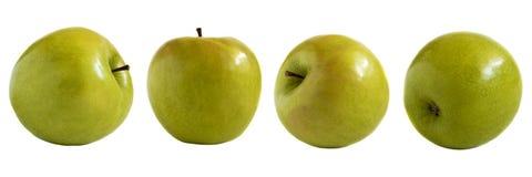 Esverdeie as maçãs isoladas foto de stock