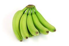 Esverdeie bananas no fundo branco Fotografia de Stock