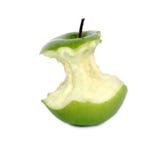 Esverdeie o núcleo da maçã Fotografia de Stock