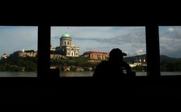 Esztergom - Hungary. There is Esztergom from a Slovakian restaurant boat with a silhouette of a man Stock Photography