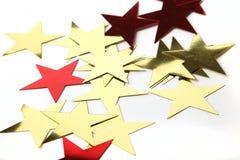 Or et étoiles métalliques rouges Photo libre de droits