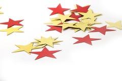 Or et étoiles métalliques rouges Image stock