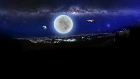 ET aircraft and UFO over jeddah city at night Stock Images