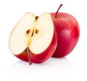 On et les pommes à moitié rouges ont isolé le fond blanc Photo libre de droits