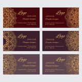 Et of luxury golden ornaments on brown background with sample text. Mandala business card design template vector collection. Set of luxury golden ornaments on Stock Illustration