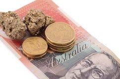 Or et pièces de monnaie sur le dollar australien Photo stock