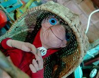 ET stuffed toy from 80`s movie, laying in straw crib royalty free stock image