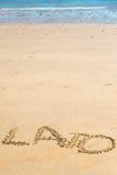 et x27 ; Lato& x27 ; mot écrit sur le sable Photos stock