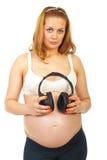 ακουστικά που κρατούν τ&eta Στοκ φωτογραφίες με δικαίωμα ελεύθερης χρήσης