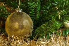 Etail of golden decoration on the christmas tree with gold chain. Stock Images