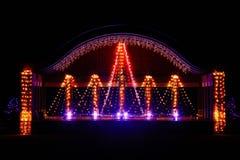 Etapa adornada con las luces de la Navidad Fotos de archivo