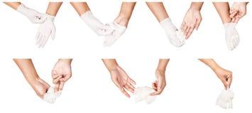 Etapa da mão que joga afastado as luvas descartáveis brancas médicas foto de stock