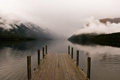 Etapa de aterrizaje en el lago de la persona chapada a la antigua Fotos de archivo libres de regalías