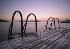 Etapas ao mar e ao farol Imagens de Stock Royalty Free