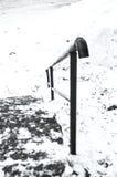 Etapas das escadas na neve para baixo Imagem de Stock Royalty Free