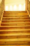 Etapas de madeira à luz Imagem de Stock Royalty Free