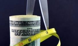 Etatverkürzungen/Aufblasen Stockbild