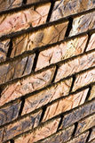Etched Brick Wall. Downward slanted view of a brick wall.  The bricks have etched marks on them Stock Photo