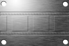 Etched film strip. On metal plate Royalty Free Stock Photos