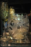 Etched glassware. Stemware and cups engraved and etched stock photo