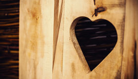 Etched Heart in Wooden Door. Conceptual composition, etched heart in wooden door, closeup view royalty free stock photos