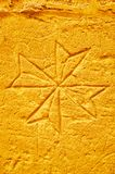 Etched Maltese Cross, Old Prison of Rabat, Victoria, Gozo, Malta. VICTORIA, MALTA - JUNE 15, 2018: The etched Maltese Cross depicted by medieval prisonner on the stock photo
